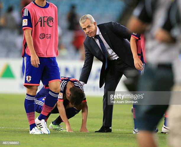 Japan Head coach Javier Aguirre consoles Shinji Kagawa after Japan lose the penalty shoot out over United Arab Emirates during the 2015 Asian Cup...
