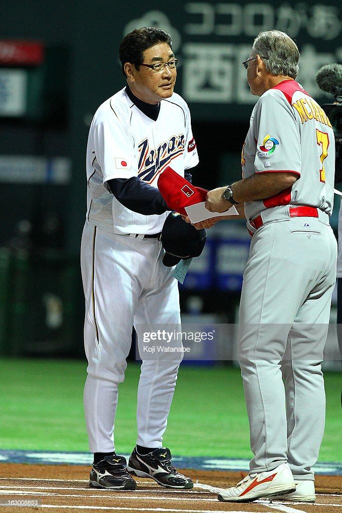 Japan Head Coach Koji Yamamoto #88 and China Head Coach John McLaren sakes hand during the World Baseball Classic First Round Group A game between Japan and China at Fukuoka Yahoo! Japan Dome on March 3, 2013 in Fukuoka, Japan.