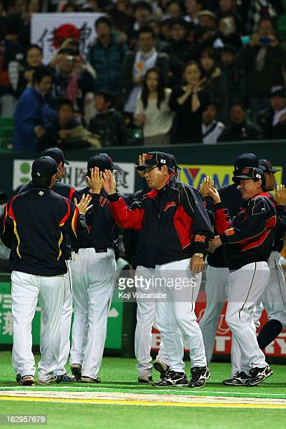 Japan Head Coach Koji Yamamoto celebrates the win after the World Baseball Classic First Round Group A game between Brazil and Japan at Fukuoka Yahoo...