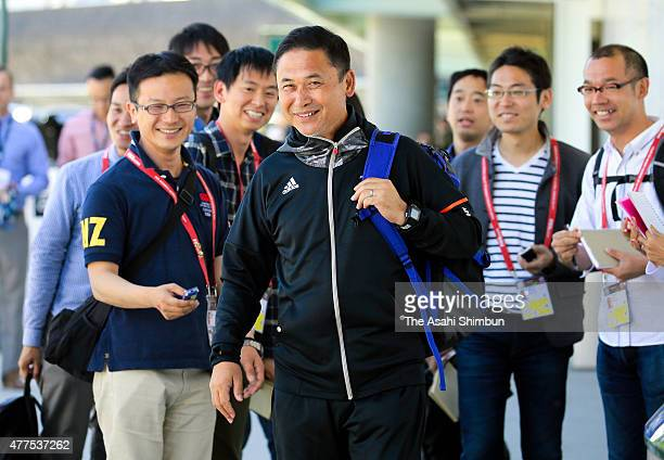 Japan head coach Norio Sasaki smiles on arrival at vancouver International Airport on June 17, 2015 in Vancourver, Canada.