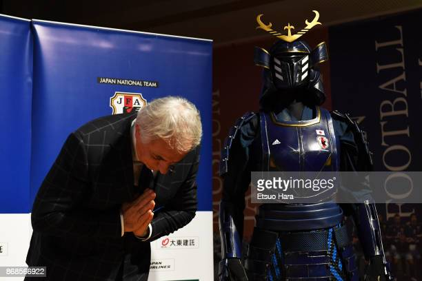 Japan head coach Vahid Halilhodzic bows next to a Samurai armour during a press conference announcing the squad playing against Brazil and Belgium at...
