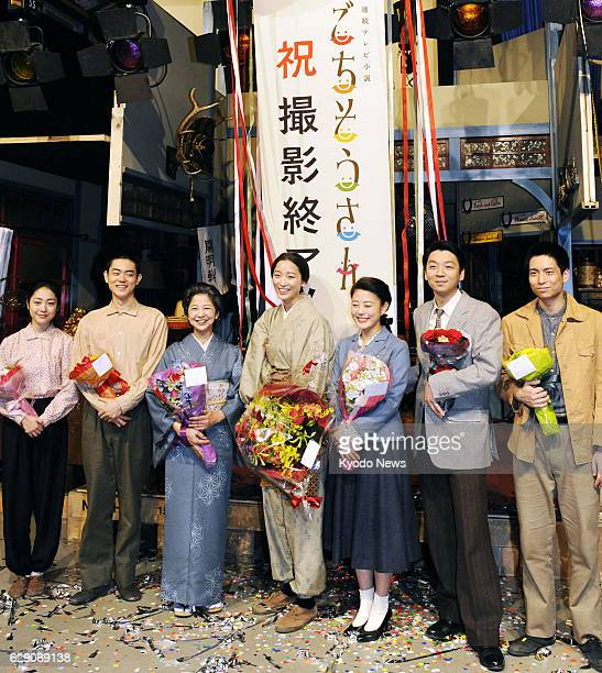 "Japan - Heroine Anne Watanabe and other cast members of Japanese public broadcaster NHK's serial morning TV drama ""Gochisousan"" pose after the..."