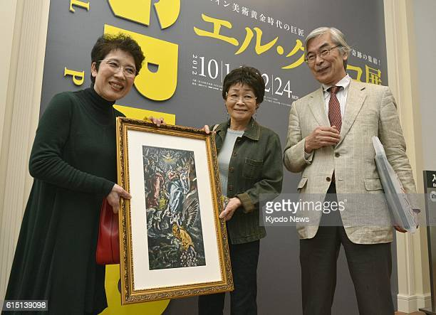 OSAKA Japan Hisako Miyatake holds a gift given by Toshio Yamanashi director of the National Museum of Art as she became the 10 millionth visitor to...