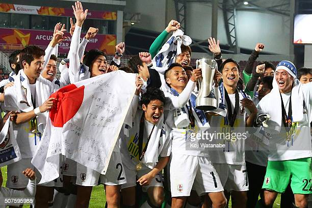 Japan holds up the trophy during the celebration after the AFC U23 Championship final match between South Korea and Japan at the Abdullah Bin Khalifa...