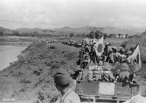 Japan Imperial Army soldiers advance to entry to Lang Son in September 1940 in French Indochina