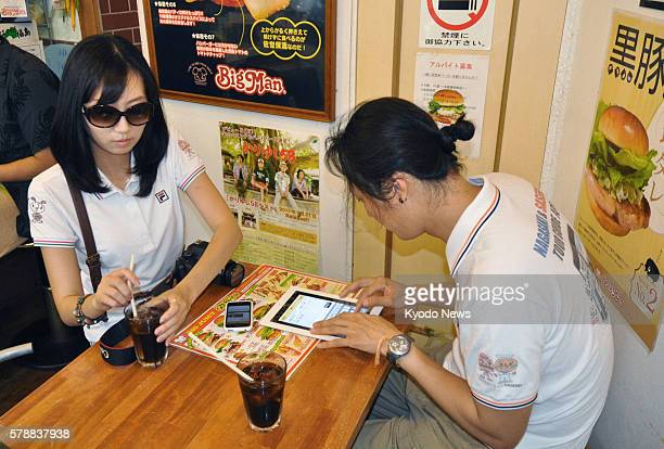 SASEBO Japan In Ji Hae from South Korea visits a Sasebo Burger shop in Sasebo Nagasaki Prefecture southwestern Japan on July 25 after obtaining...