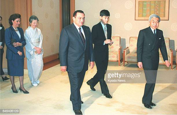 Japan - In this April 1999 file photo, Japanese Emperor Akihito , and his wife, Empress Michiko , welcome Egyptian President Hosni Mubarak and his...