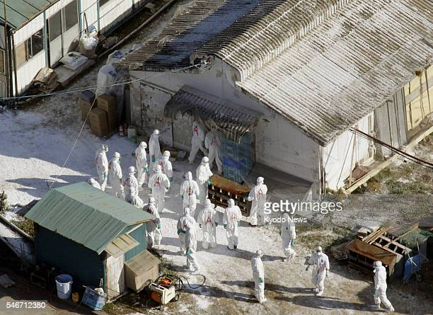 Japan - Inspectors in protective gear enter a poultry farm in the city of Miyazaki on Jan. 22 after an outbreak of a highly pathogenic avian flu...