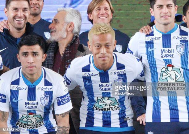 Japan international midfielder Keisuke Honda poses for a photo with fellow new signees of Mexican soccer club Pachuca Edson Puch and Angel Sagal in...
