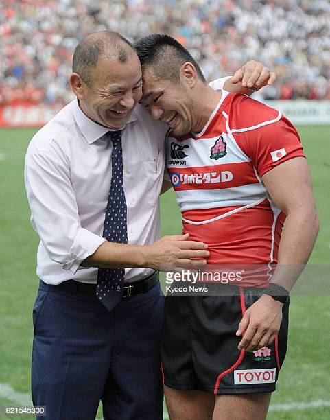 Japan - Japan coach Eddie Jones and captain Toshiaki Hirose celebrate after Japan beat Wales 23-8 at the Prince Chichibu Memorial Rugby Ground in...