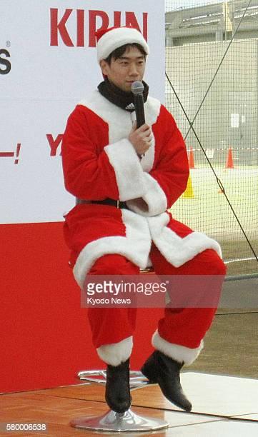 Japan - Japan midfielder Shinji Kagawa in Santa Claus costume speaks at a Christmas event in Sendai, Miyagi Prefecture, on Dec. 24, 2011. About 300...