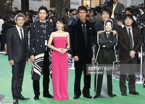 TOKYO Japan Japanese actor Hiroshi Abe and actress Satomi Ishihara stand on the green carpet made of materials recycled from plastic bottles in...