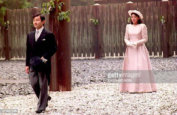 Japanese Crown Prince Naruhito and Princess Masako leave the outer shrine at the Ise Grand Shrine 26 June, 1993. The newlyweds visited the Grand...