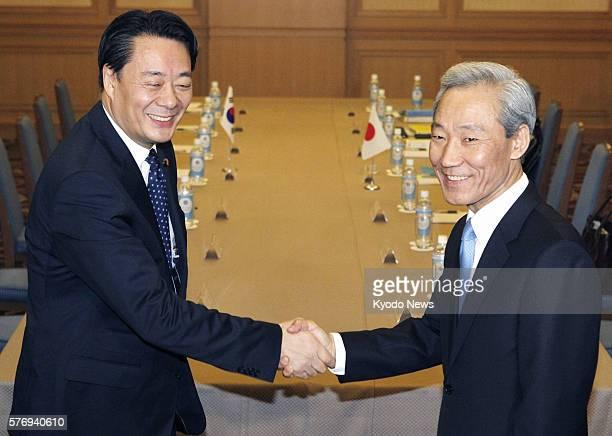 TOKYO Japan Japanese Economy Trade and Industry Minister Banri Kaieda and South Korean Trade Minister Kim Jong Hoon shake hands in Tokyo on April 24...