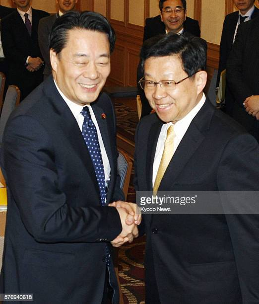 TOKYO Japan Japanese Economy Trade and Industry Minister Banri Kaieda and Chinese Commerce Minister Chen Deming shake hands in Tokyo on April 24...