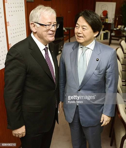 TOKYO Japan Japanese farm minister Yoshimasa Hayashi greets Australian Trade and Investment Minister Andrew Robb before their free trade talks at the...