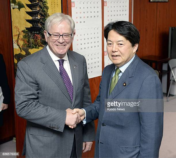 TOKYO Japan Japanese farm minister Yoshimasa Hayashi shakes hands with Australian trade minister Andrew Robb ahead of talks at the farm ministry in...