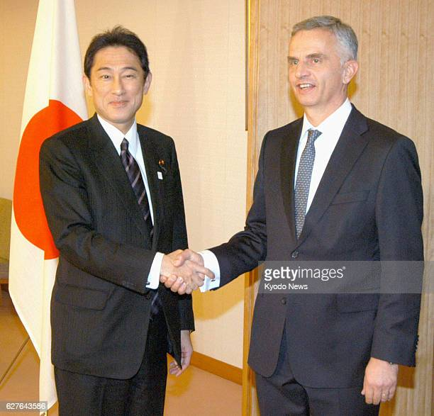 TOKYO Japan Japanese Foreign Minister Fumio Kishida shakes hands with Swiss President Didier Burkhalter prior to their meeting at the ministry in...