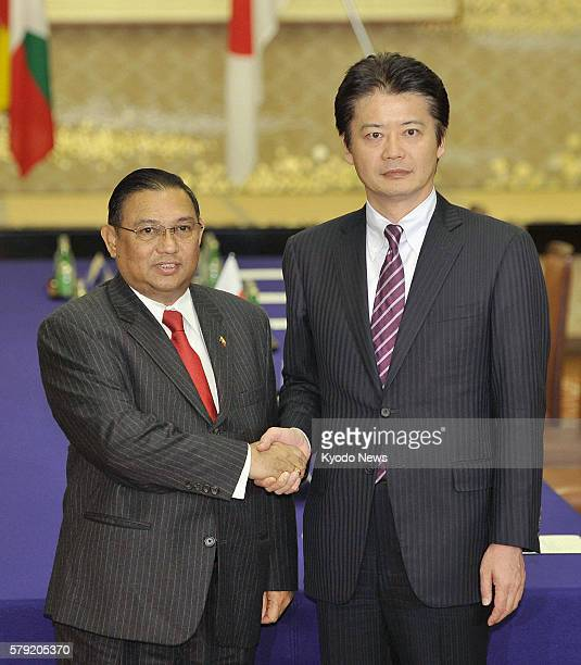 TOKYO Japan Japanese Foreign Minister Koichiro Gemba shakes hands with his Myanmar counterpart Wunna Maung Lwin ahead of their talks in Tokyo on Oct...