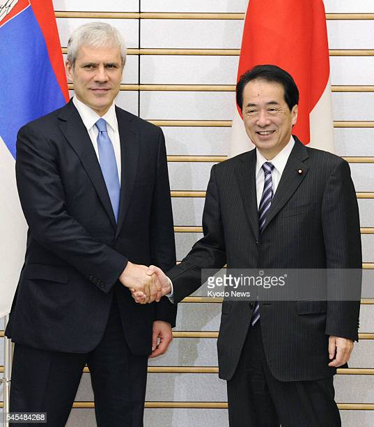 TOKYO Japan Japanese Prime Minister Naoto Kan and Serbian President Boris Tadic shake hands before their meeting at the premier's office in Tokyo on...