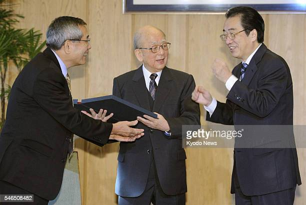 TOKYO Japan Japanese Prime Minister Naoto Kan chats with Nobel Prize winners in chemistry Akira Suzuki a professor emeritus at Hokkaido University...