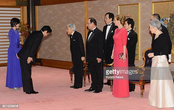 TOKYO Japan Japanese Prime Minister Shinzo Abe accompanied by his wife Akie exchanges a greeting with Emperor Akihito ahead of a banquet at the...