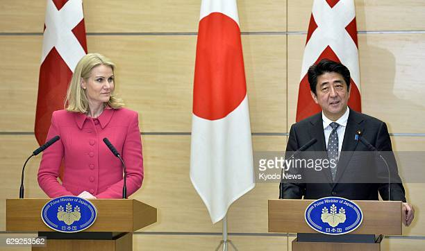 TOKYO Japan Japanese Prime Minister Shinzo Abe and his Danish counterpart Helle ThorningSchmidt hold a joint press conference after their talks at...