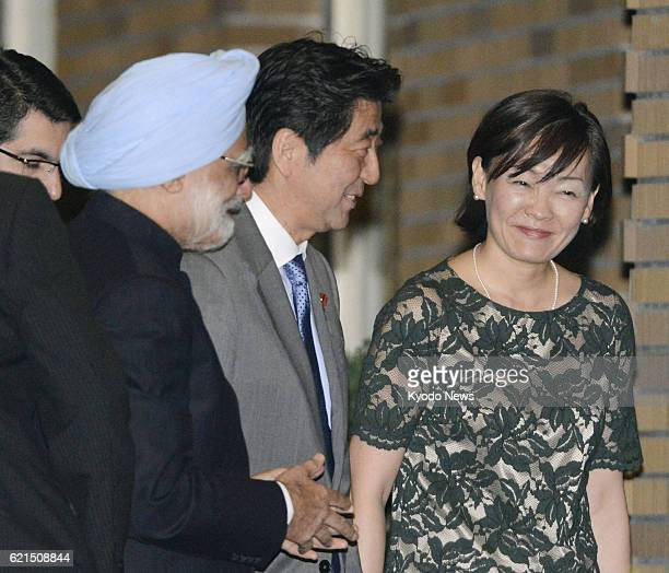 TOKYO Japan Japanese Prime Minister Shinzo Abe and his wife Akie greet Indian Prime Minister Manmohan Singh as Singh visits the couple at Abe's...