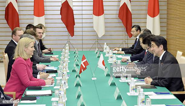 TOKYO Japan Japanese Prime Minister Shinzo Abe holds talks with his Danish counterpart Helle ThorningSchmidt at Abe's office in Tokyo on March 4 2014