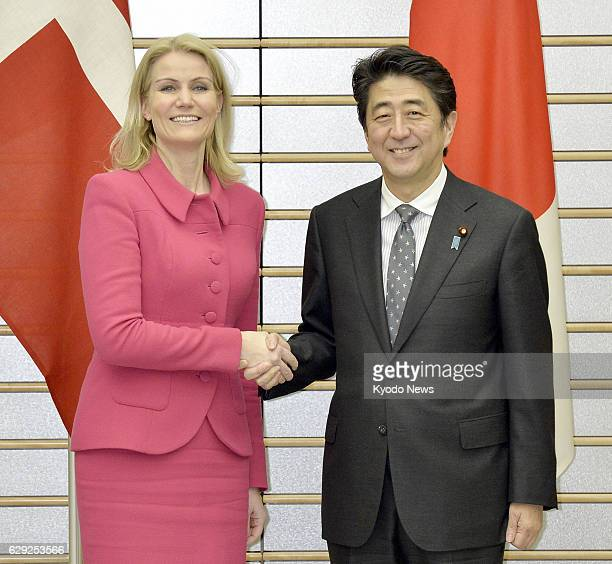 TOKYO Japan Japanese Prime Minister Shinzo Abe shakes hands with his Danish counterpart Helle ThorningSchmidt ahead of their talks at Abe's office in...