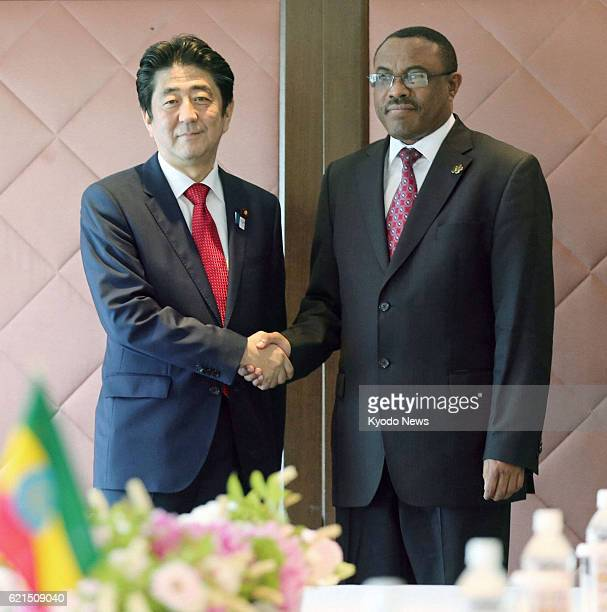 YOKOHAMA Japan Japanese Prime Minister Shinzo Abe shakes hands with his Ethiopian counterpart Hailemariam Desalegn ahead of their talks at a hotel in...