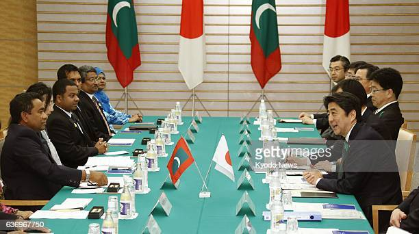 TOKYO Japan Japanese Prime Minister Shinzo Abe speaks during a meeting with Maldives President Abdulla Yameen in Tokyo on April 15 2014