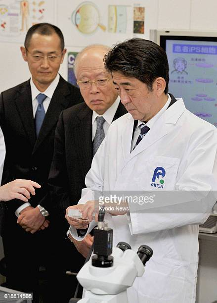 Japan - Japanese Prime Minister Shinzo Abe visits a laboratory belonging to Riken, a company that deals with the research of induced pluripotent stem...