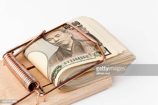 Japan japanese yen banknotes in a mouse trap