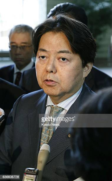 TOKYO Japan Japan's Agriculture Forestry and Fisheries Minister Yoshimasa Hayashi answers reporters' questions in Tokyo on April 13 2014 Two chickens...