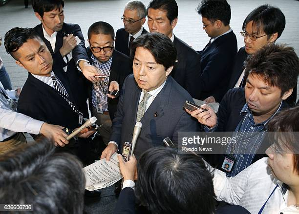 TOKYO Japan Japan's Agriculture Forestry and Fisheries Minister Yoshimasa Hayashi is surrounded by reporters in Tokyo on April 13 2014 Two chickens...