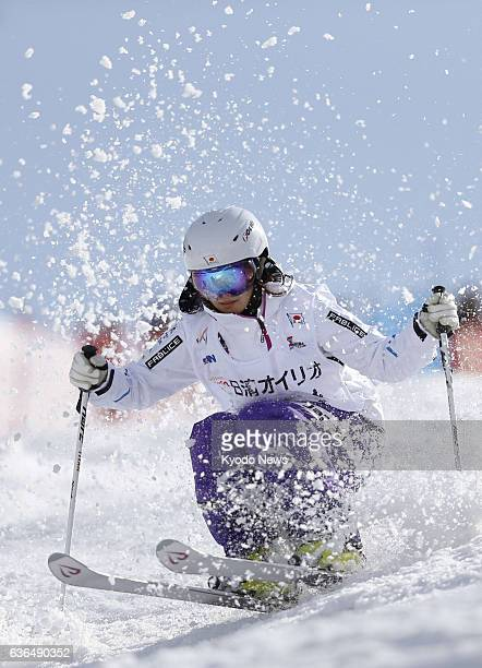HAKUBA Japan Japan's Aiko Uemura hurtles down the piste during her first run in the women's moguls final at the freestyle skiing national...
