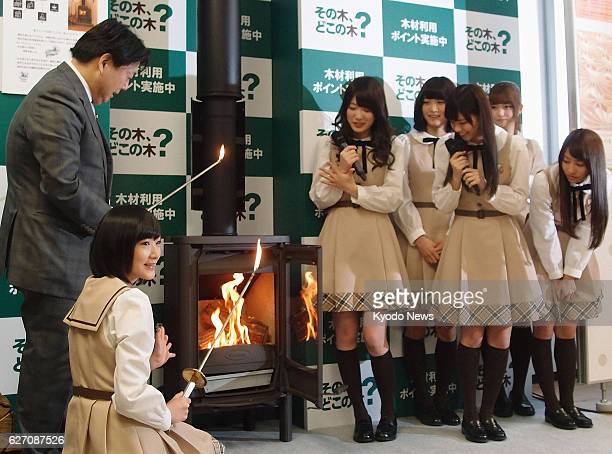 TOKYO Japan Japan's farm minister Yoshimasa Hayashi and members of the pop idol group Nogizaka46 attend an event at the farm ministry in Tokyo on Jan...