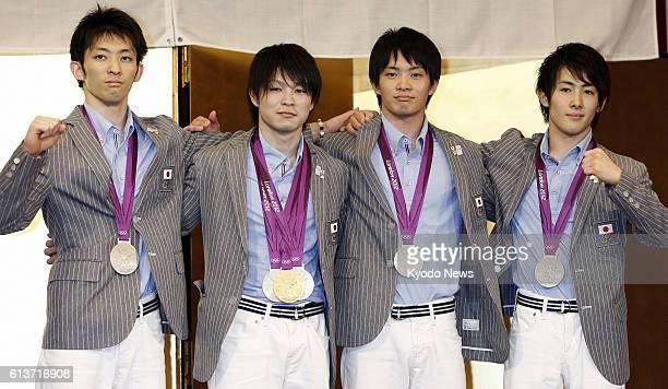 TOKYO Japan Japan's Kazuhito Tanaka Kohei Uchimura Yusuke Tanaka and Ryohei Kato pose for photographs during a press conference at a hotel in Tokyo...