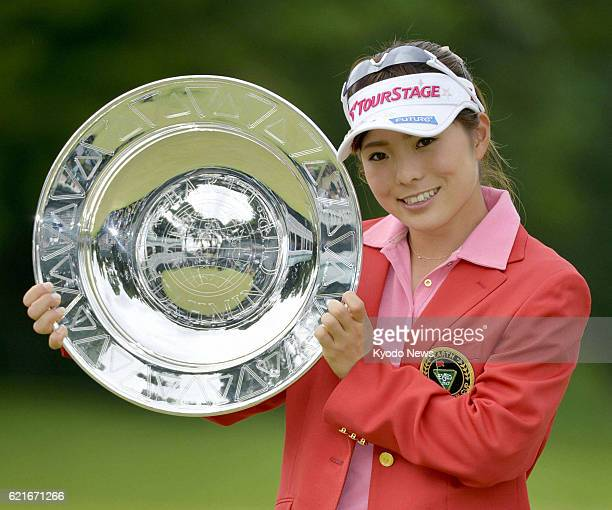 SODEGAURA Japan Japan's Natsuka Hori holds the victor's trophy after winning the Earth Mondahmin Cup at Camellia Hills Country Club in Chiba...