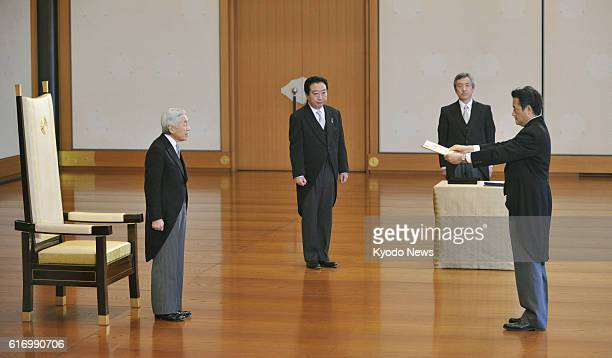 TOKYO Japan Japan's new Deputy Prime Minister Katsuya Okada is attested by Emperor Akihito during a ceremony at the Imperial Palace in Tokyo on Jan...