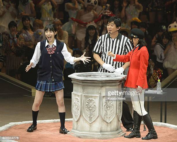 Japan - Jurina Matsui of the pop idol groups SKE48 and AKB48 reacts after winning a rock-paper-scissors tournament before some 12,000 fans at the...