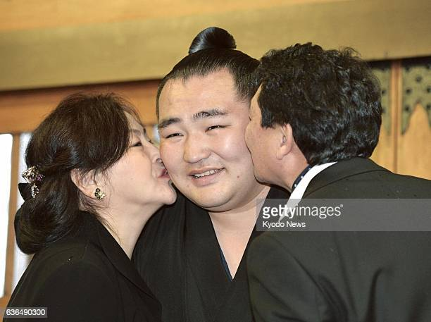 OSAKA Japan Kakuryu is kissed by his parents in Osaka on March 26 after the Japan Sumo Association formally promoted the Mongolianborn ozeki to...