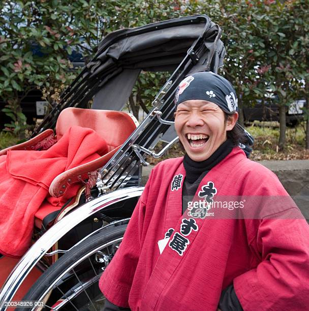 Japan, Kamakura, rickshaw driver laughing
