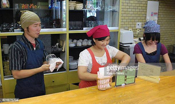 NAGOYA Japan Kazushi Suganuma watches young people working at a coffee shop in Nagoya operated by his support association on Aug 6 2013 Suganuma...