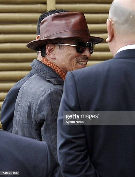 Japan - Kenichi Shinoda , the head of Yamaguchi-gumi, Japan's largest crime syndicate, arrives at the head office of the group in Kobe, after being...