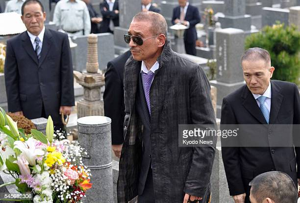 Japan - Kenichi Shinoda , the head of Yamaguchi-gumi, Japan's largest crime syndicate, visits a grave in Kobe, after being released from prison in...