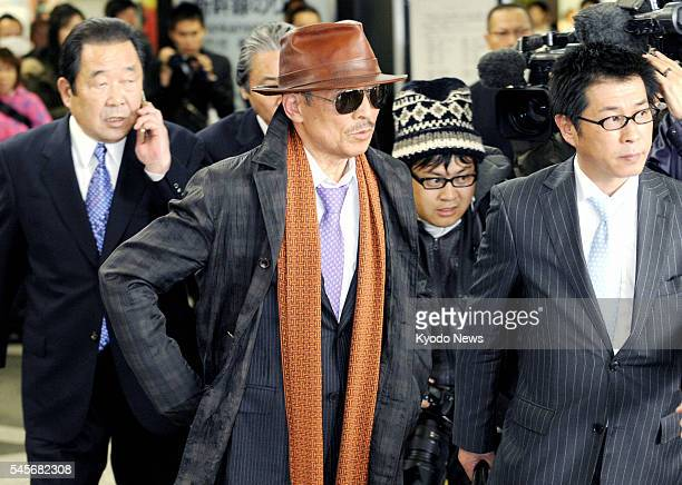 Japan - Kenichi Shinoda , the head of Yamaguchi-gumi, Japan's largest crime syndicate, arrives at a train station in Kobe city, where the group's...