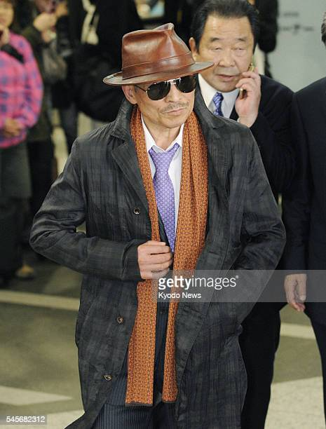 Japan - Kenichi Shinoda, the head of Yamaguchi-gumi, Japan's largest crime syndicate, arrives at a train station in Kobe city, where the group's...