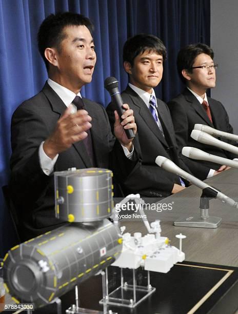 TOKYO Japan Kimiya Yui Takuya Onishi and Norishige Kanai attend a press conference in Tokyo on July 27 one day after the Japan Aerospace Exploration...